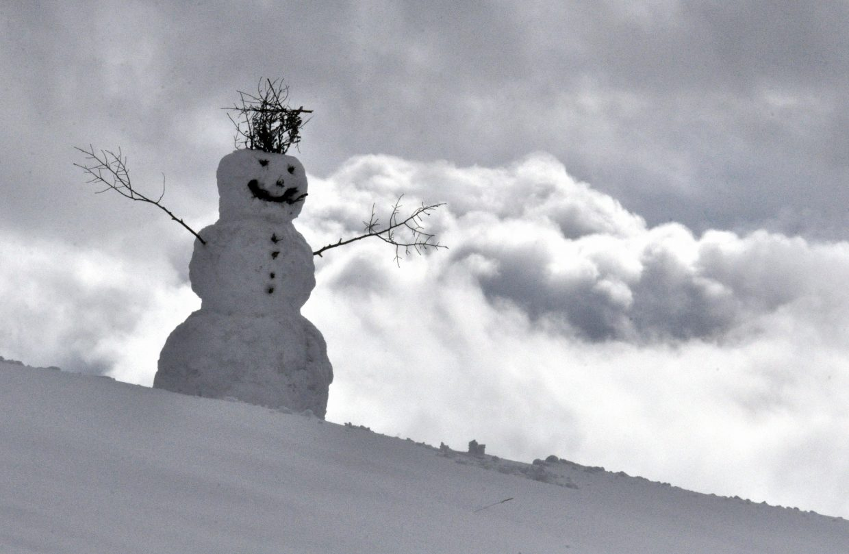 A snowman graces a hill in Rita Valentine Park on Tuesday afternoon.