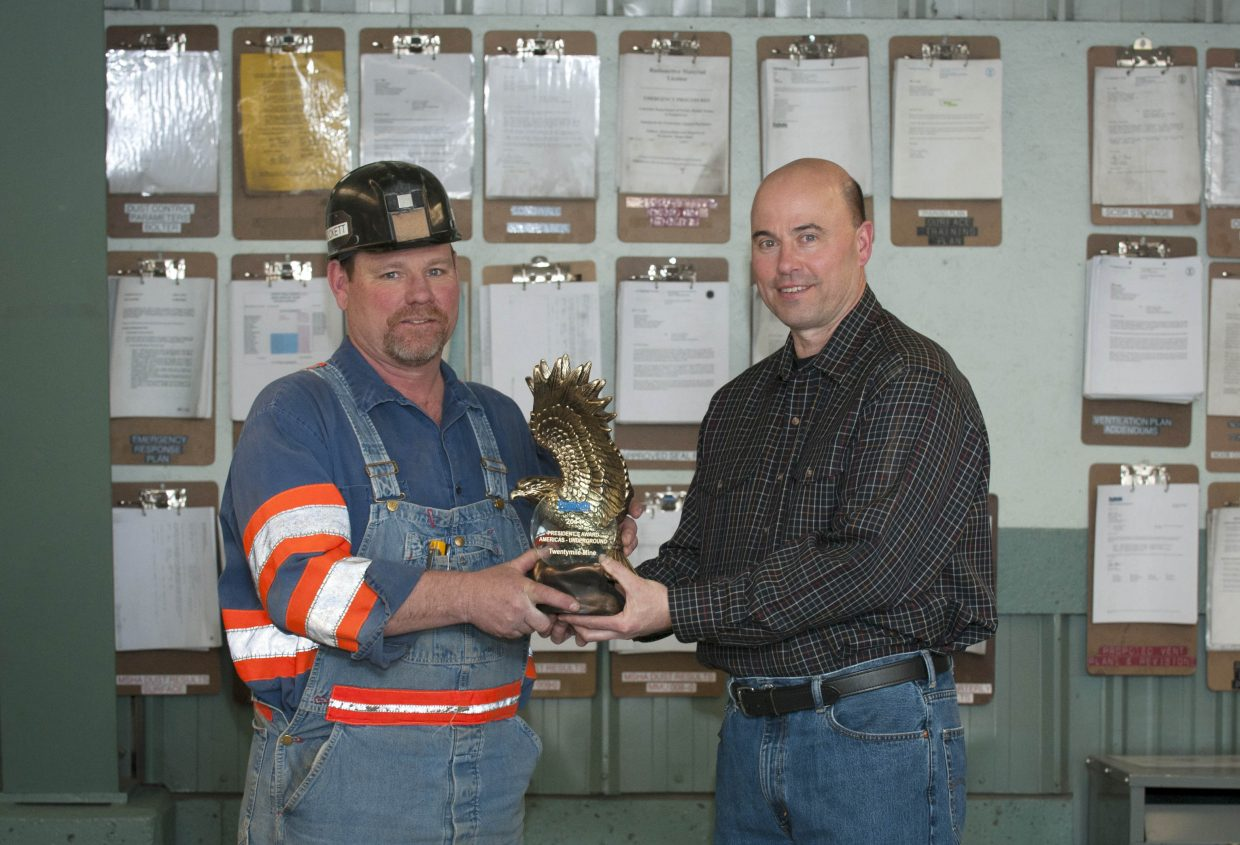 Peabody Energy Americas President Kemal Williamson poses with the President's Award with Twentymile Mine Operations Manager Ron Hockett.