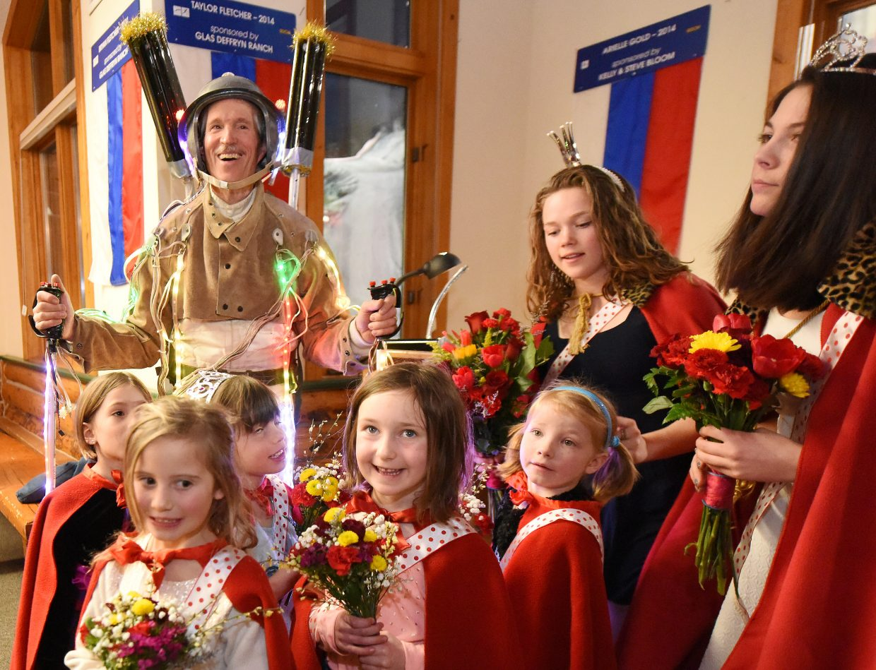 Jon Banks, the Lighted Man, smiles as he and the Winter Carnival queen, attendants and little princesses line up for a photo together Wednesday evening at Olympian Hall at Howelsen Hill. Wednesday's event signaled the start of this year's Winter Carnival.