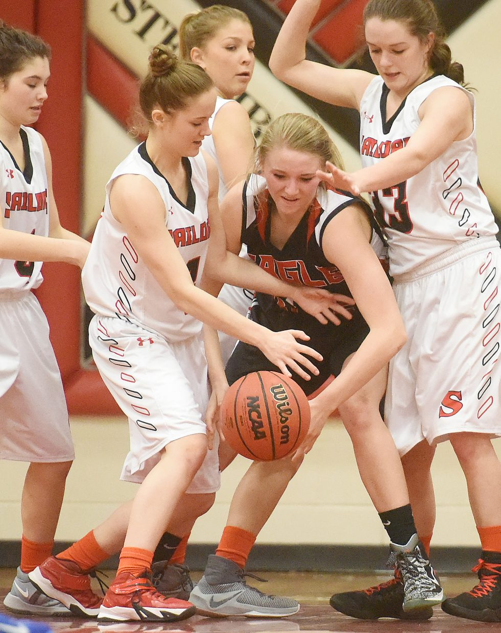 The Steamboat Springs High School girls basketball team gangs up on defense Friday against Eagle Valley. The Sailors went on to lose the game, 41-34.