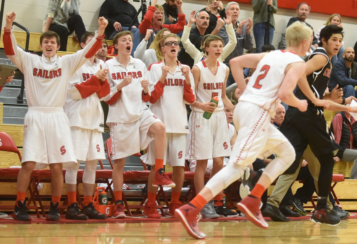The bench and stands erupt after Steamboat's Ethan Riniker scores with 15 seconds remaining in Friday night's 48-47 win against Eagle Valley.