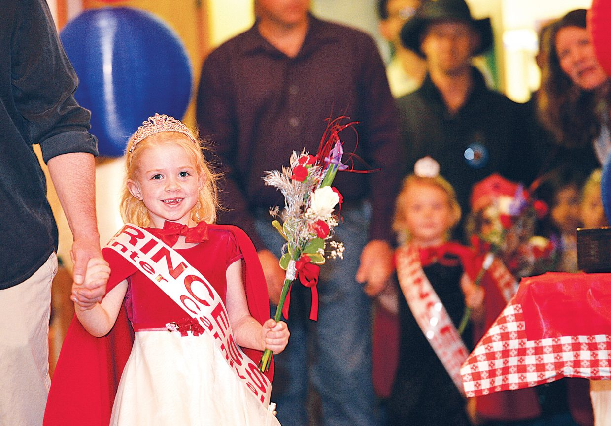 """Skylar Davison has always dreamed of being a Winter Carnival Princess, and she got her chance Wednesday night during the 102nd Winter Carnival Opening Ceremonies at Howelsen Hill Lodge in Olympian Hall. The evening included this year's Winter Carnival Royalty, the princesses and a special appearance by Jon Banks who is better known as the """"Lighted Man."""""""