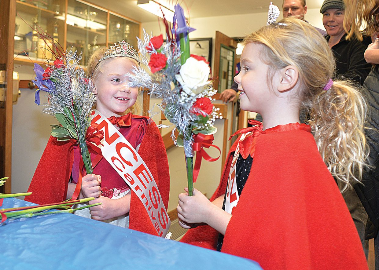 Skylar Davison, left, and Jordyn Lottes check out the flowers evening during the 102nd Winter Carnival Opening Ceremonies in 2017.