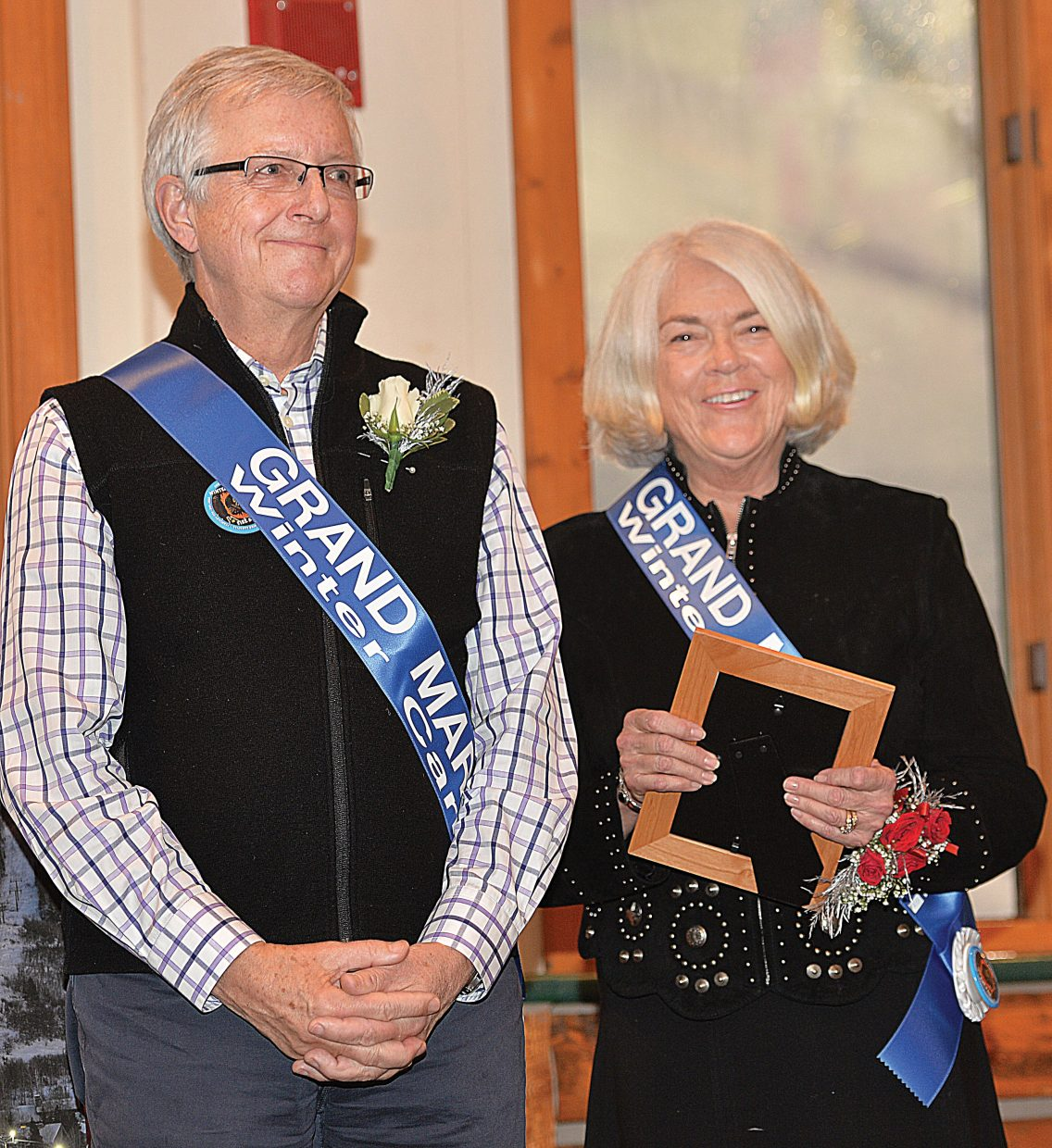 This year's Winter Carnival's grand marshals, Chris and Eileen Diamond, took center stage during Wednesday evening's Opening Ceremonies inside Olympian Hall at the Howelsen Hill Lodge.