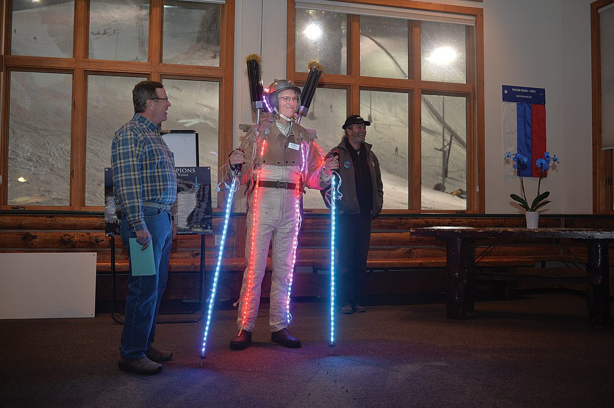 Claudius Banks was the first Lighted Man for the Steamboat Springs Winter Carnival, where he wore a suit with over 200 lights that weighed 100 pounds. Today, the tradition is carried on by Jon Banks, his son, who wears about 70 pounds worth of firework gear and lights. It takes a team to put together Banks' costume.