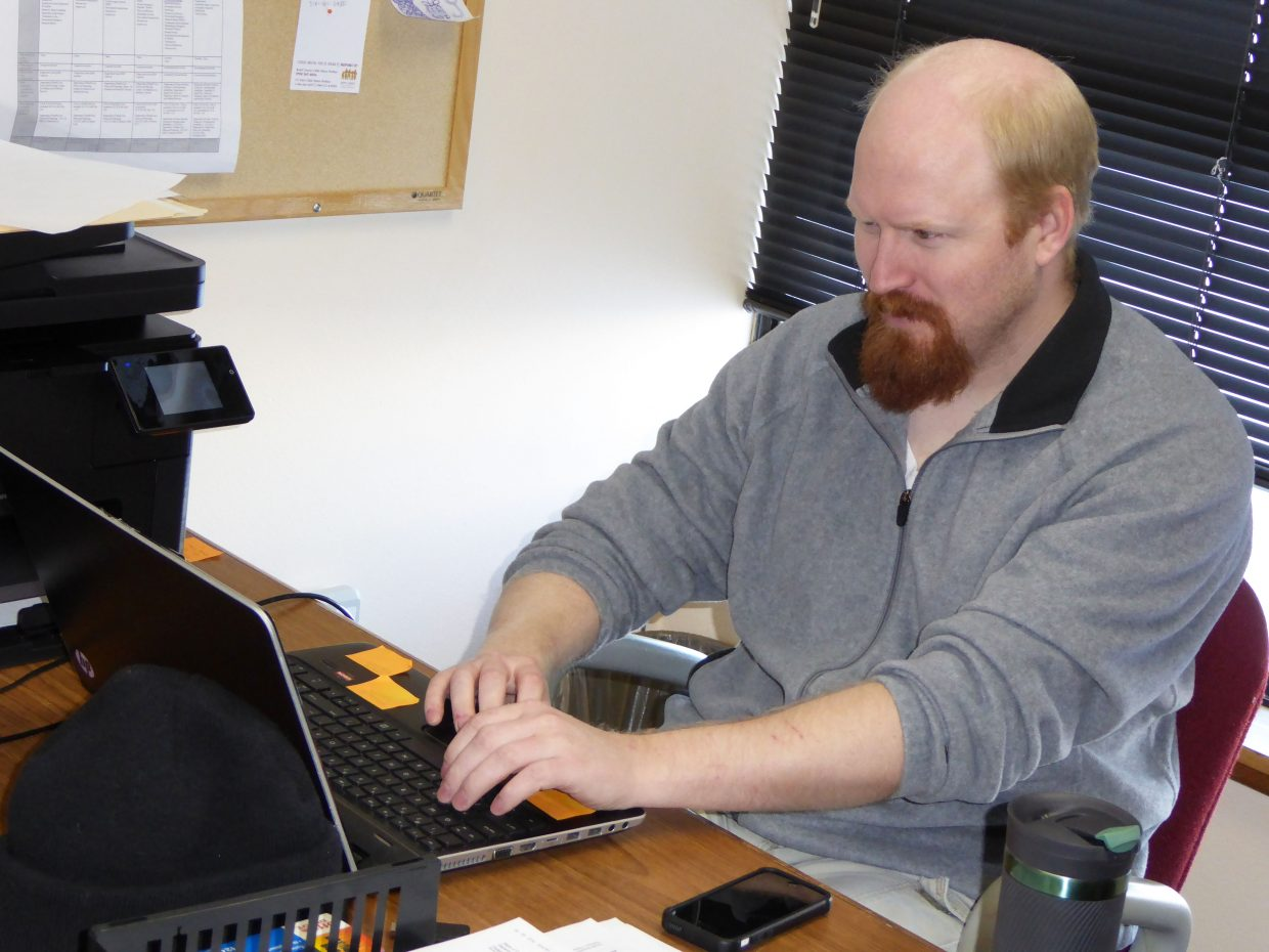 Micheal Bertram, direct service supervisor for the Northwest Colorado Center for Independence, works in his office in Craig.