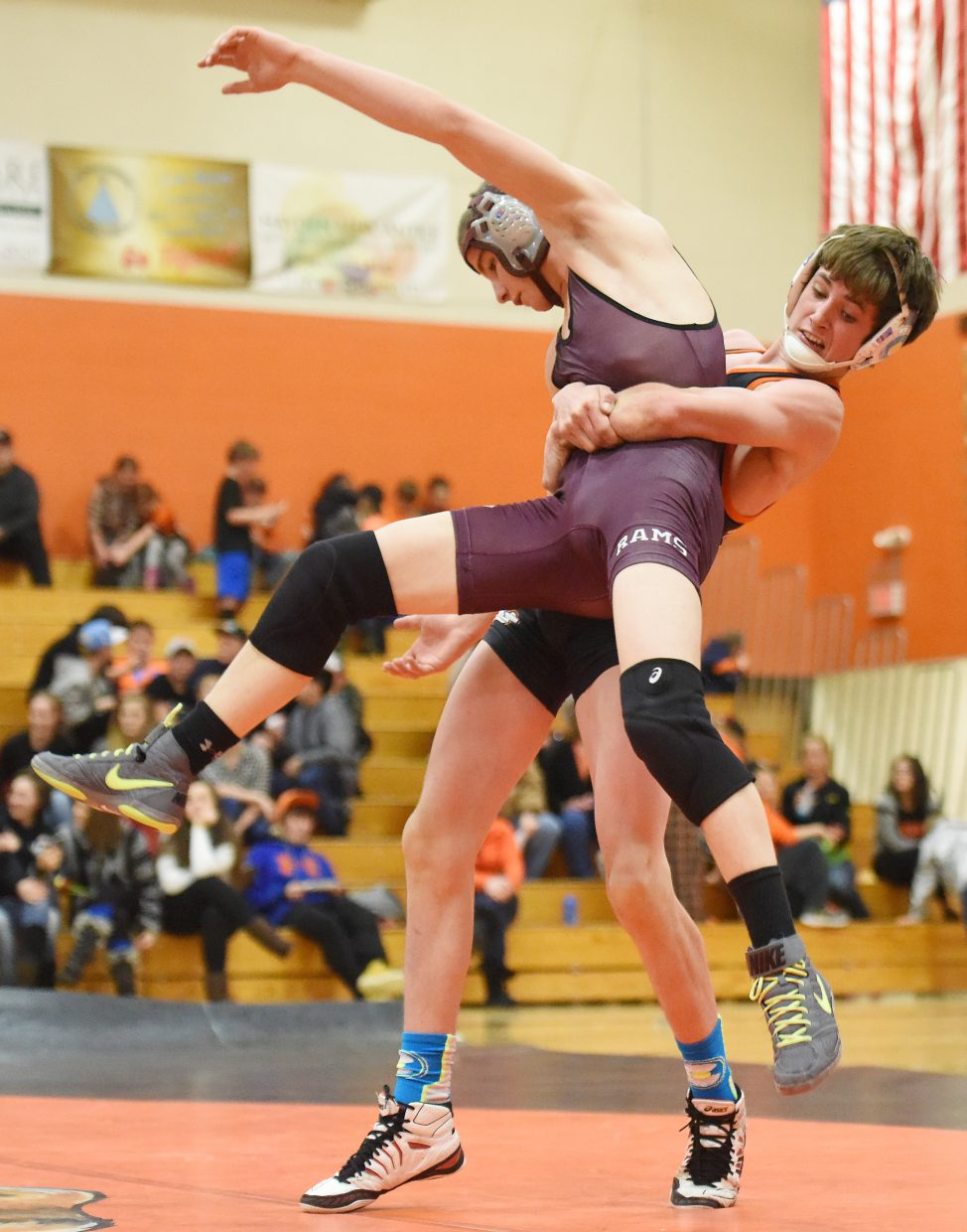 Hayden senior Judd Magee tries to toss Soroco's Lane Martindale back to the mat Thursday during a triangular in Hayden. Martindale tried desperately to make up points, but Magee managed to hold on and win the match, 4-2.