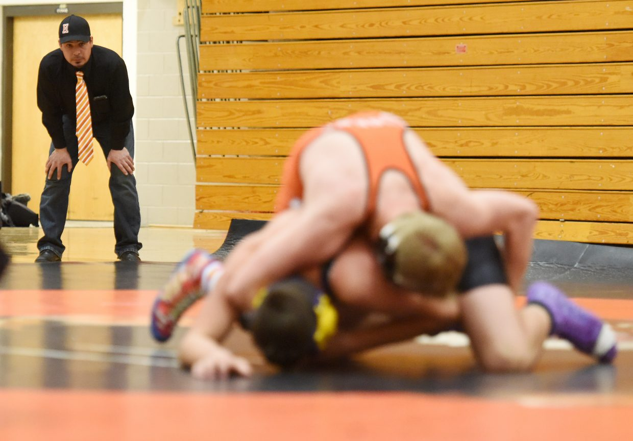 Hayden coach Chad Jones looks on during a wrestling match Thursday night.