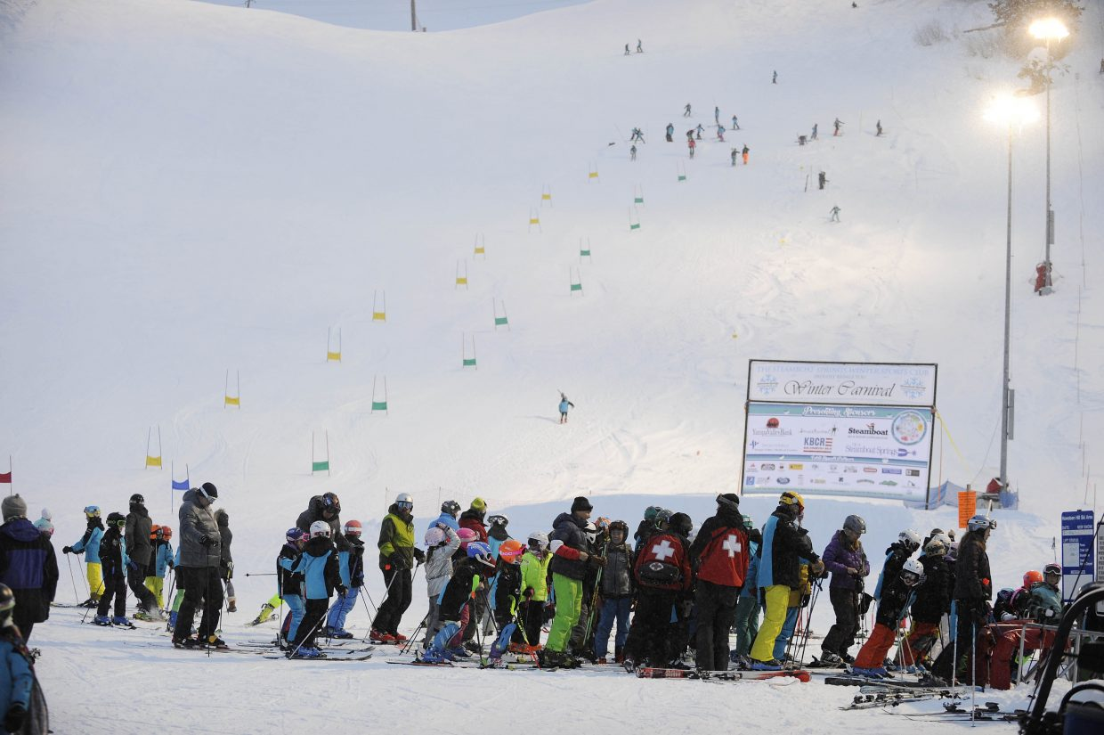 People line up to get up Howelsen Hill during Winter Carnival events on Thursday.