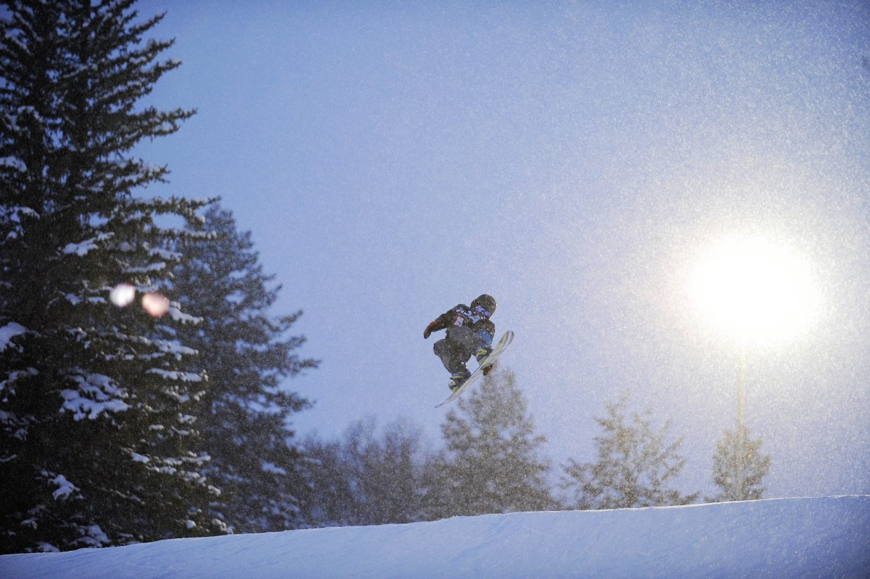 Johnny Duty does a trick in the terrain park during Winter Carnival events on Thursday night at Howelsen Hill.