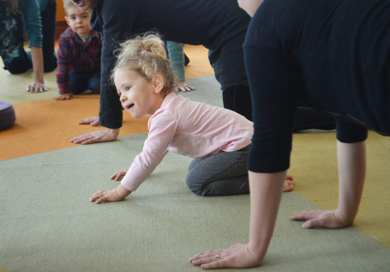 Emilia Petti, 2, practices her yoga moves during Story Stretchers, a storytime and yoga group at Bud Werner Memorial Library.