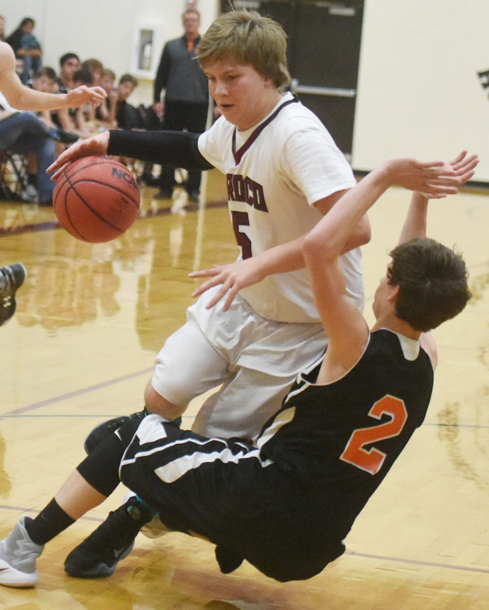 Soroco's Colton Stroup and Hayden's Garrett St. Clair collide Saturday as the Rams beat the Tigers, 48-38.
