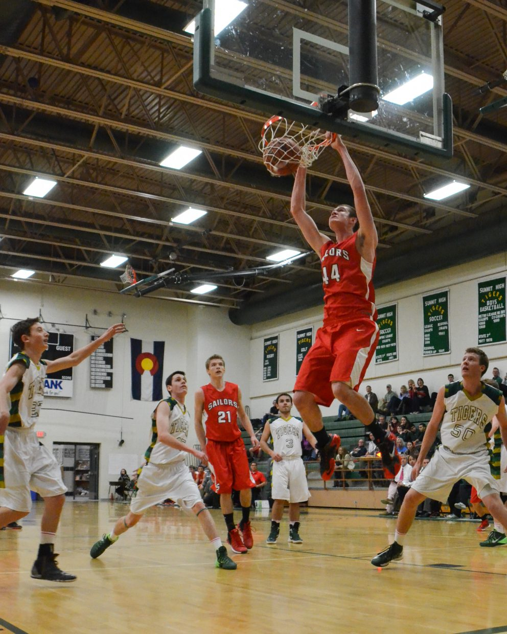 Garrett Bye slams down one of many dunks during Steamboat's 66-44 victory against Summit County.