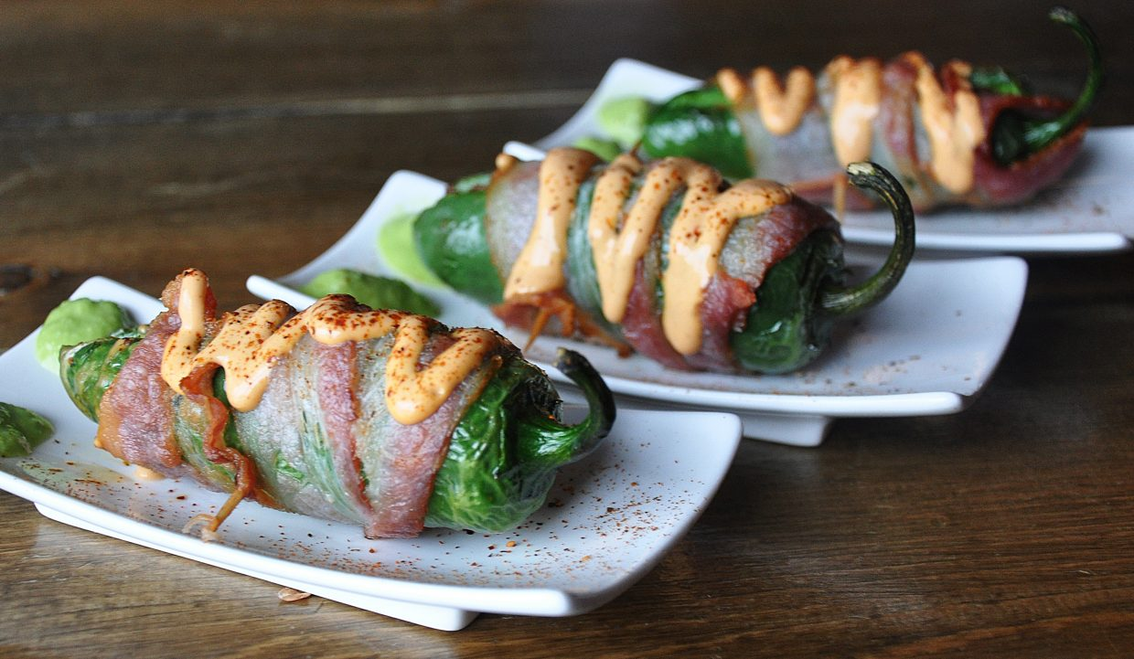 Rattlesnake Bites at the Double Diamonds Bar consist of a shrimp-stuffed, bacon-wrapped jalapenos.