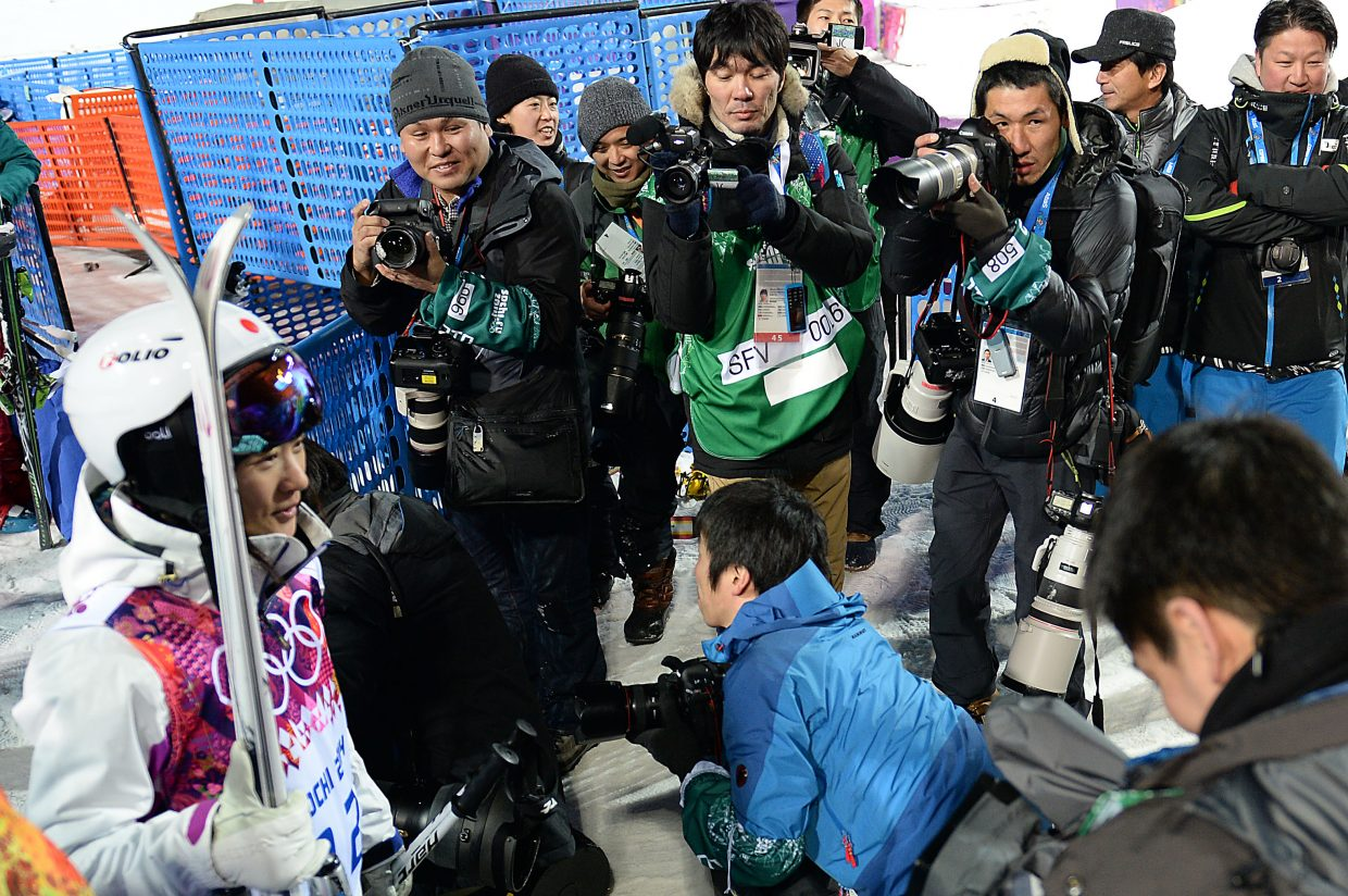 Japanese freestyle skier Aiko Uemura's every step was followed by photographers Thursday at the women's moguls qualifying round. She earned the love, too, finishing sixth.