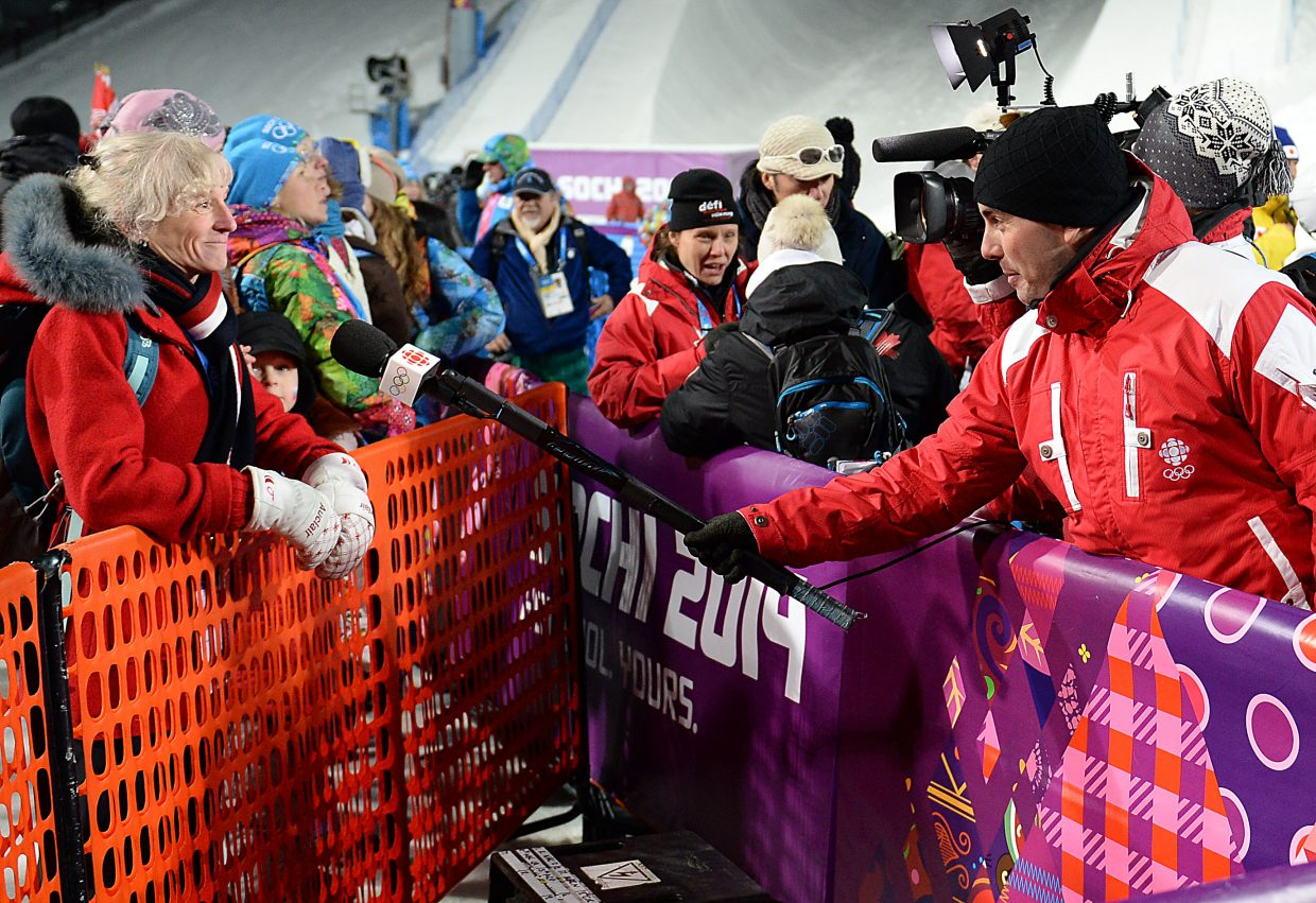 "The media at the 2014 Olympics is stopped by nothing. Jill Kearney, Hannah Kearney's mother, is interviewed Thursday after the women's moguls preliminary competitions with the trusty old ""microphone on a stick."""
