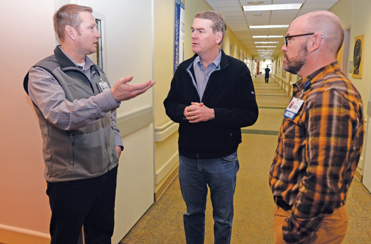 Democratic senator Michael Bennet visits with Chief Financial Officer, Bryan Roach (left) and Chief Medical Officer, Ken Lindsey while touring the Yampa Valley Medical Center Friday afternoon. Bennet was one of several senators to introduce a bipartisan bill that helps rural hospitals.