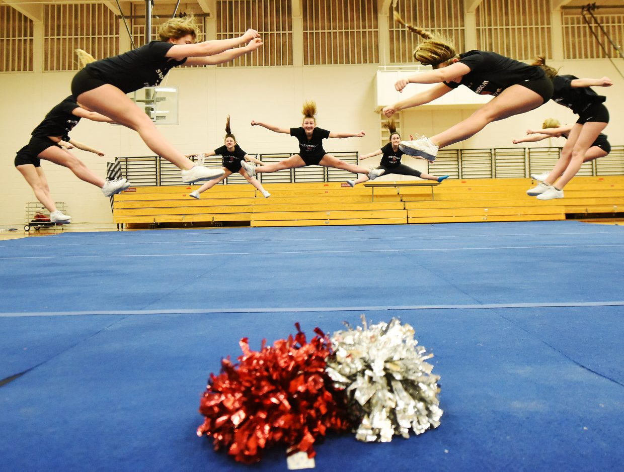 The Steamboat Springs High School cheerleading squad leaps through its routine Wednesday during a final practice before it headed to Orlando, Florida for a nationals competition.