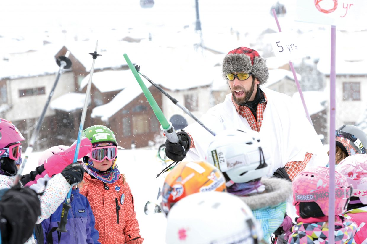 Adult volunteer Andy Kerrigan organizes groups of skiers at the start of the annual Soda Pop Slalom Race at the Steamboat Ski Area Friday morning. The event is a part of the annual Steamboat Springs Winter Carnival celebration.