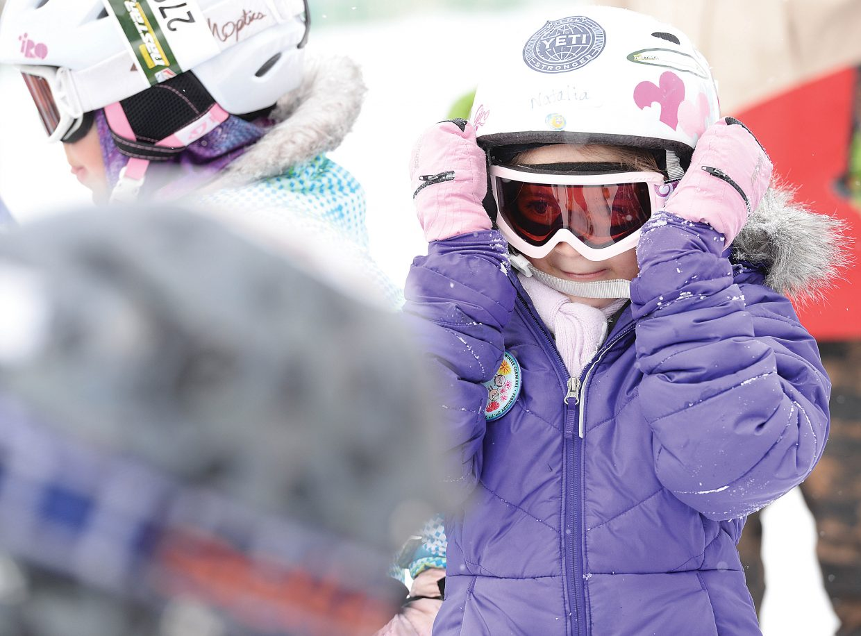 Natalia Villegas adjusts her goggles while waiting for her start in the annual Soda Pop Slalom Race at the Steamboat Ski Area Friday morning. The event is a part of the annual Steamboat Springs Winter Carnival celebration.