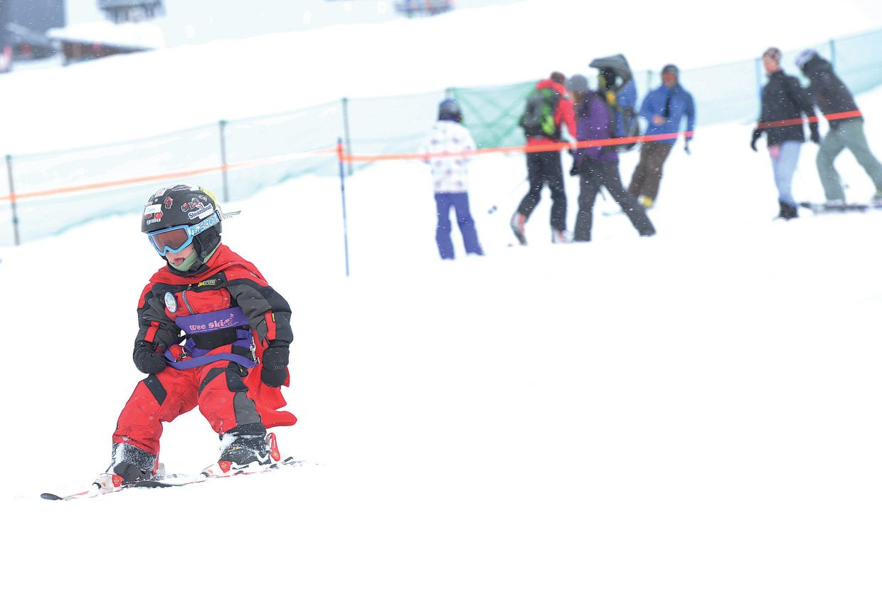 A young ski racer cruises down the slopes of the Steamboat Ski Area during the Soda Pop Slalom Race, part of the annual Steamboat Springs Winter Carnival celebration.