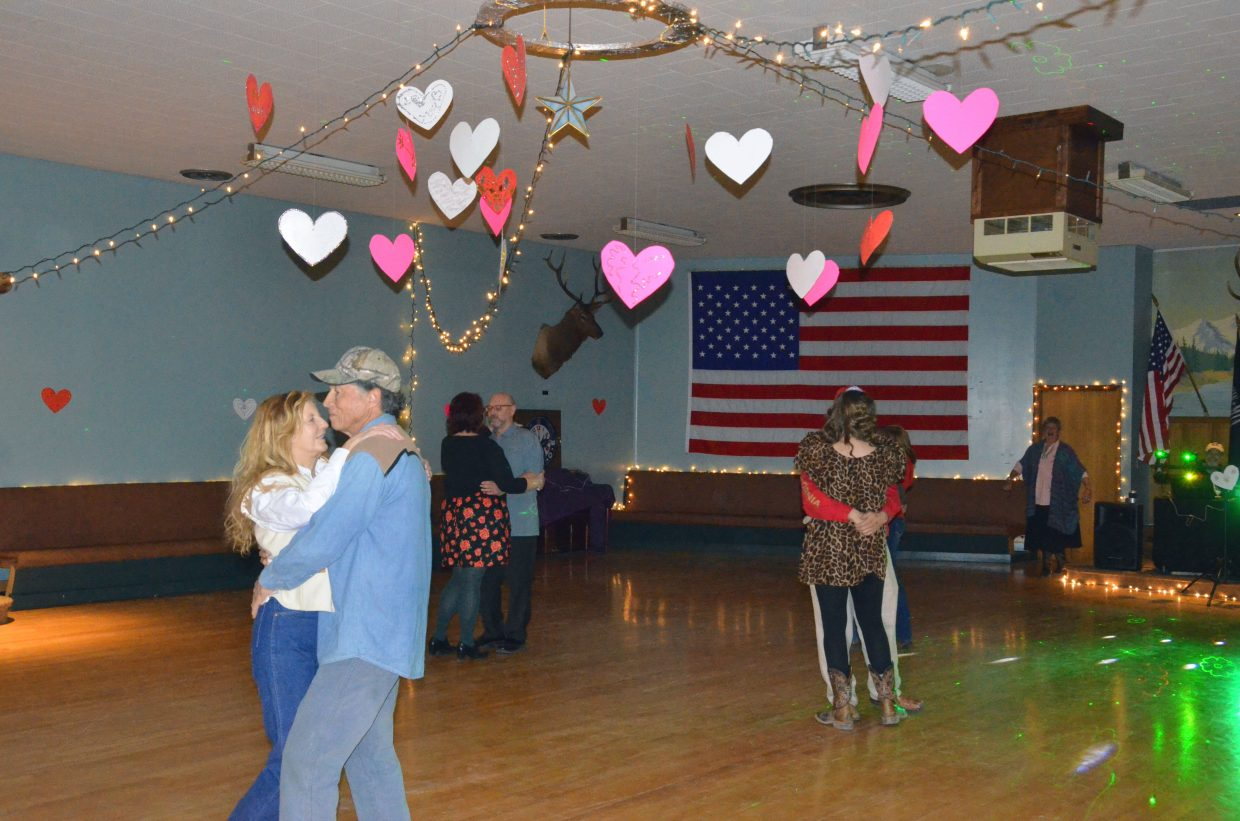 Couples sway to the music during Downtown Business Association's 2015 Valentine's Dance at the local Elks Lodge. This year's dance will take place at Center of Craig Feb. 13, concurrent with Cherish the Little Things Art Show, Art Walk and Taste of Chocolate.