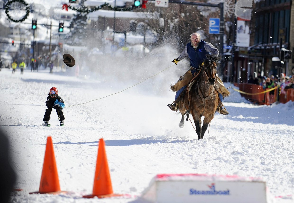 Doug Wheeler loses his hat while pulling Koen Stroock during the Winter Carnival donkey jump competition Saturday.