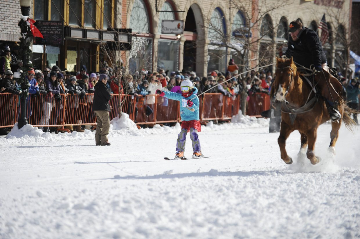 Evan Quinn is pulled down the course during the Winter Carnival skijoring competition.