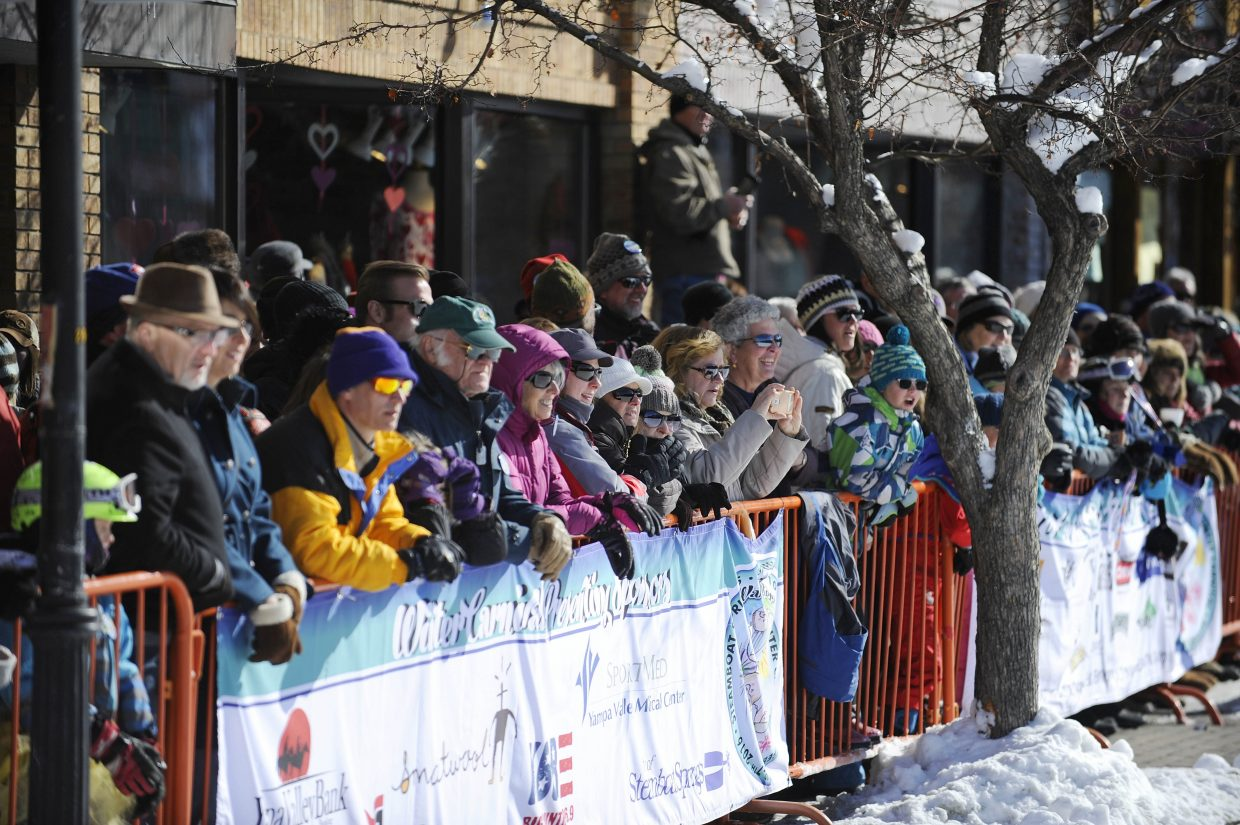 A crowd lines Lincoln Avenue during Winter Carnival.