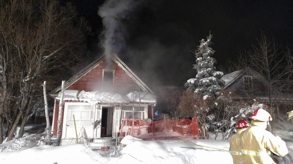 Smoke comes out of an Oak Creek home Friday night.