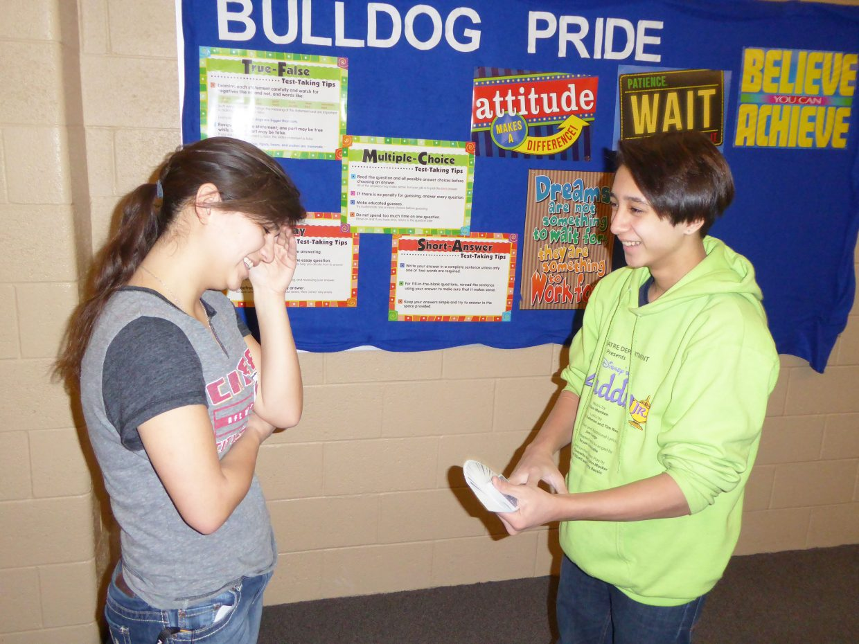 Moffat County High School Senior Bekah Bird, left, watches as Freshman Sambu Shrestha performs a magic trick at the high school. Sambu's magical prowess earned him first place in the high school's recent talent show.