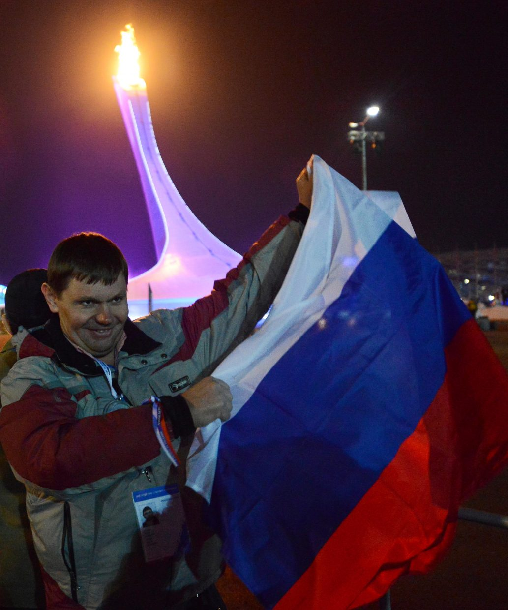 A Russian waves his country's flag Friday after the opening ceremony for the 2014 Olympic Games.