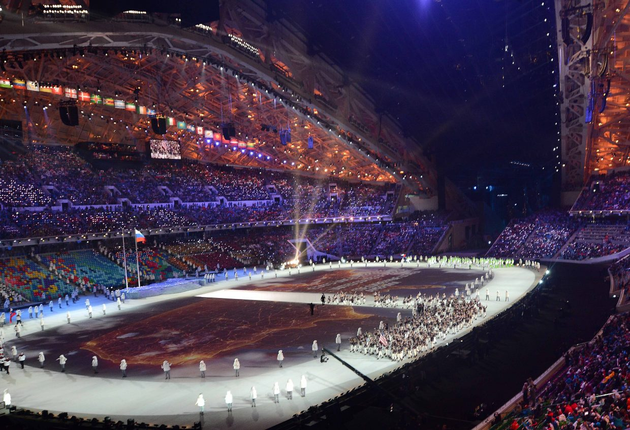 The American contingent at the opening ceremonies for the 2014 Winter Olympics makes its way around Fisht Stadium on Friday in Sochi, Russia.