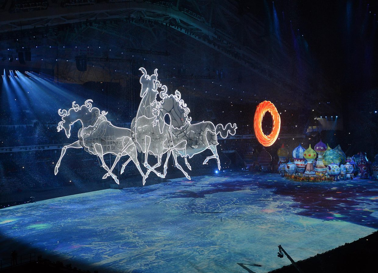 Enormous horses of light galloped across the stadium Friday at the Winter Olympics opening ceremony in Sochi, Russia.