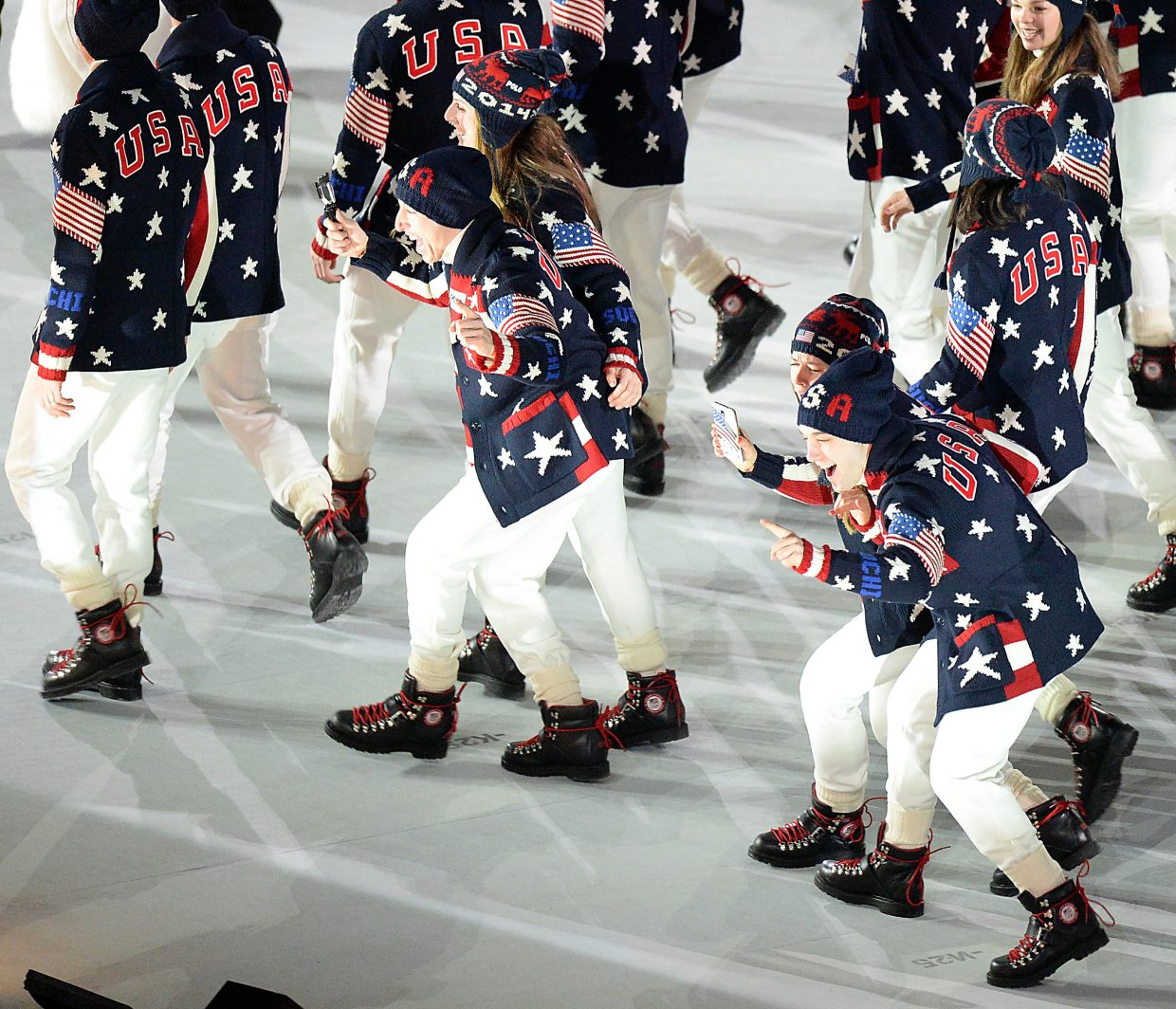 A group of American athletes mug for a camera Friday during the Winter Olympics opening ceremony in Sochi, Russia.