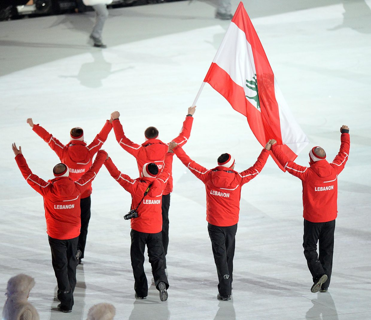 Team Lebanon marched hand in raised hand through the opening ceremony of the 2014 Winter Olympics on Friday.
