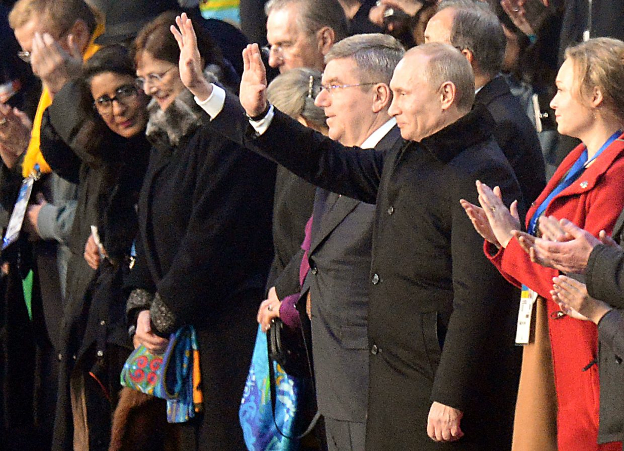 Russian President Vladimir Putin waves to the crowd at Friday's opening ceremony of the 2014 Winter Olympics.