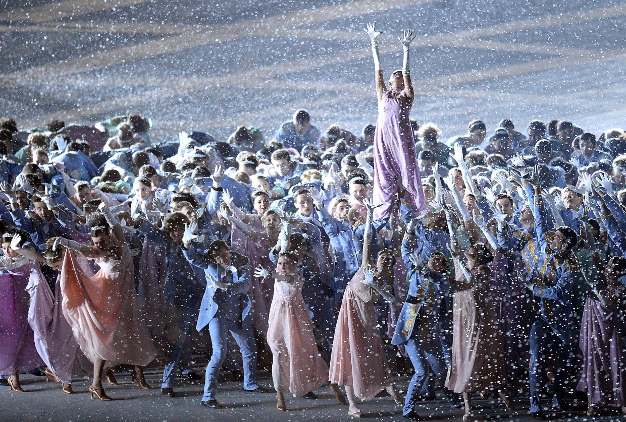 Dancers and singers aren't slowed as snow falls from the roof of Fisht Olympic Stadium on Friday during the opening ceremony for the 2014 Winter Olympics in Sochi, Russia.