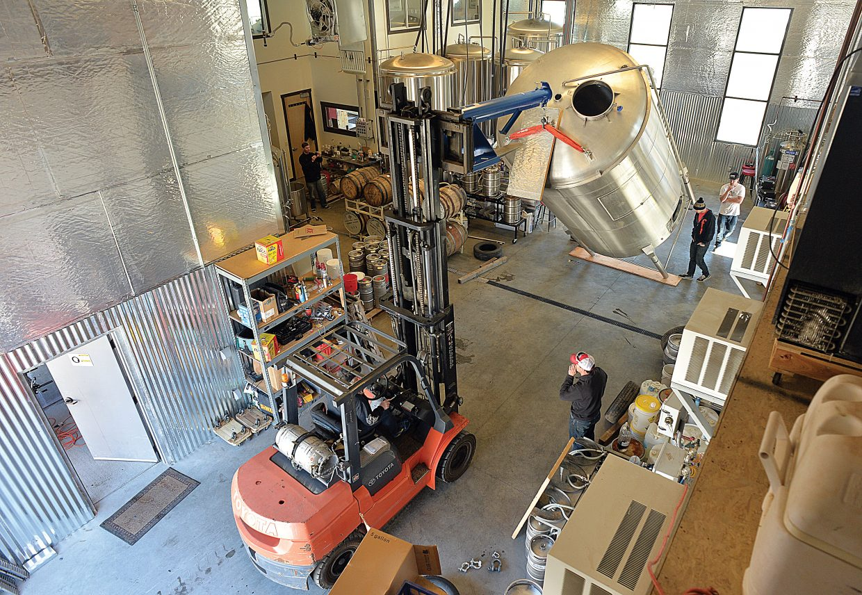 Employees of the Butcherknife Brewing Company in Steamboat Springs use a forklift to move a new 18 1/2-foot-tall kettle into their brewery located off of Routt County Road 129. The new kettle will hold 120 barrels of beer at a time.