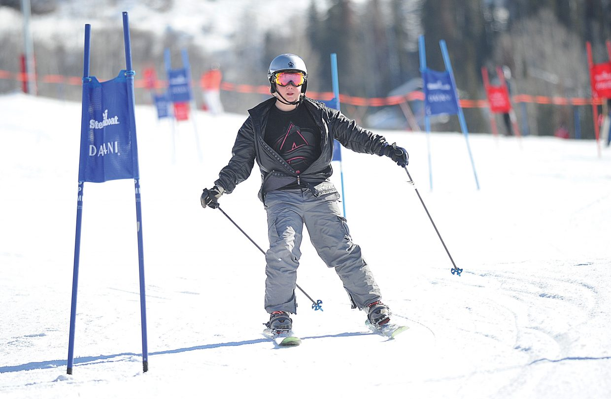 Otis Van De Carr races toward the finish line of the 2015 Soda Pop Slalom Friday morning at Steamboat Ski Area. The Steamboat Springs Winter Carnival tradition is a right-of-passage for young skiers in the Steamboat Springs area.