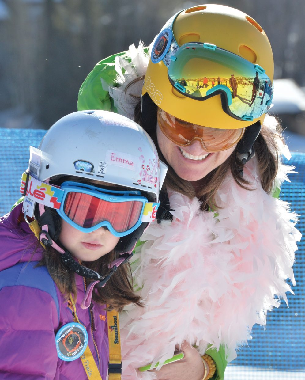 Ski racer Emma Russell gets a few last minute tips from her coach Stephanie Orozco at the starting line of the 2015 Soda Pop Slalom, which took place Friday at Steamboat Ski Area. The Steamboat Springs Winter Carnival tradition is a right-of-passage for young skiers in the Steamboat Springs area.