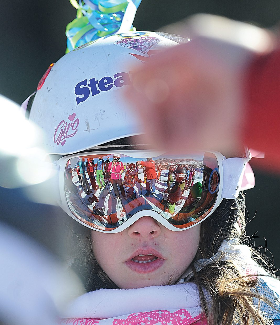 The crowd at the starting line of the 2015 Soda Pop Slalom ski race is reflected in Caley Goforth's goggles Friday morning. The Steamboat Springs Winter Carnival tradition is a right-of-passage for young skiers in the Steamboat Springs area.