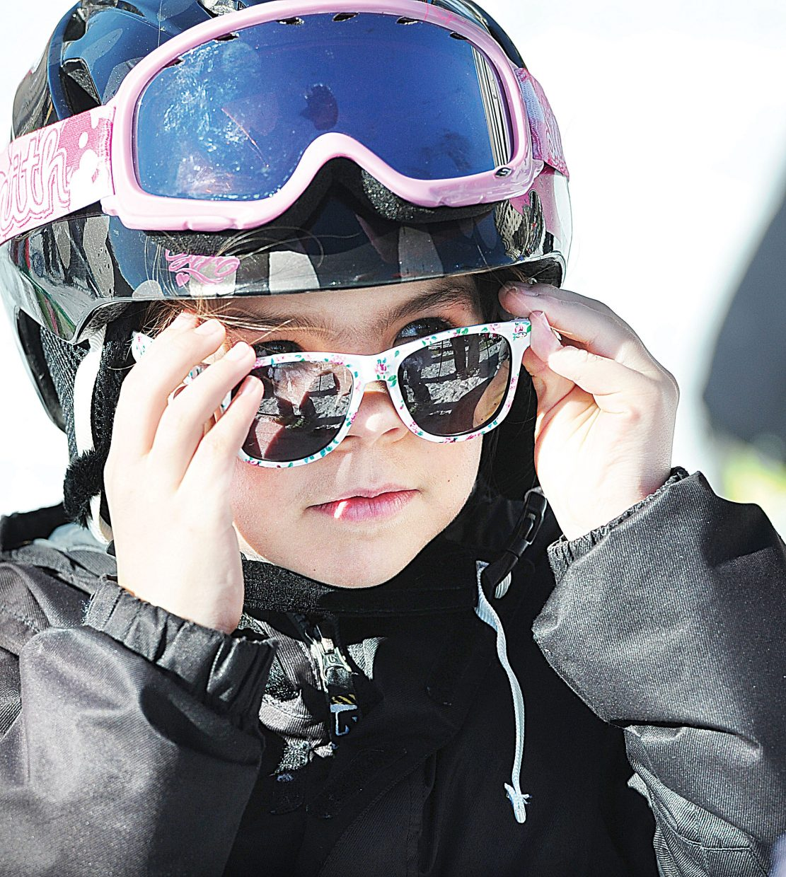 """Wylie High puts on a new pair of sunglasses that she got in the """"goodie"""" bag at the 2015 Soda Pop Slalom, which took place Friday at Steamboat Ski Area. The Steamboat Springs Winter Carnival tradition is a right-of-passage for young skiers in the Steamboat Springs area."""