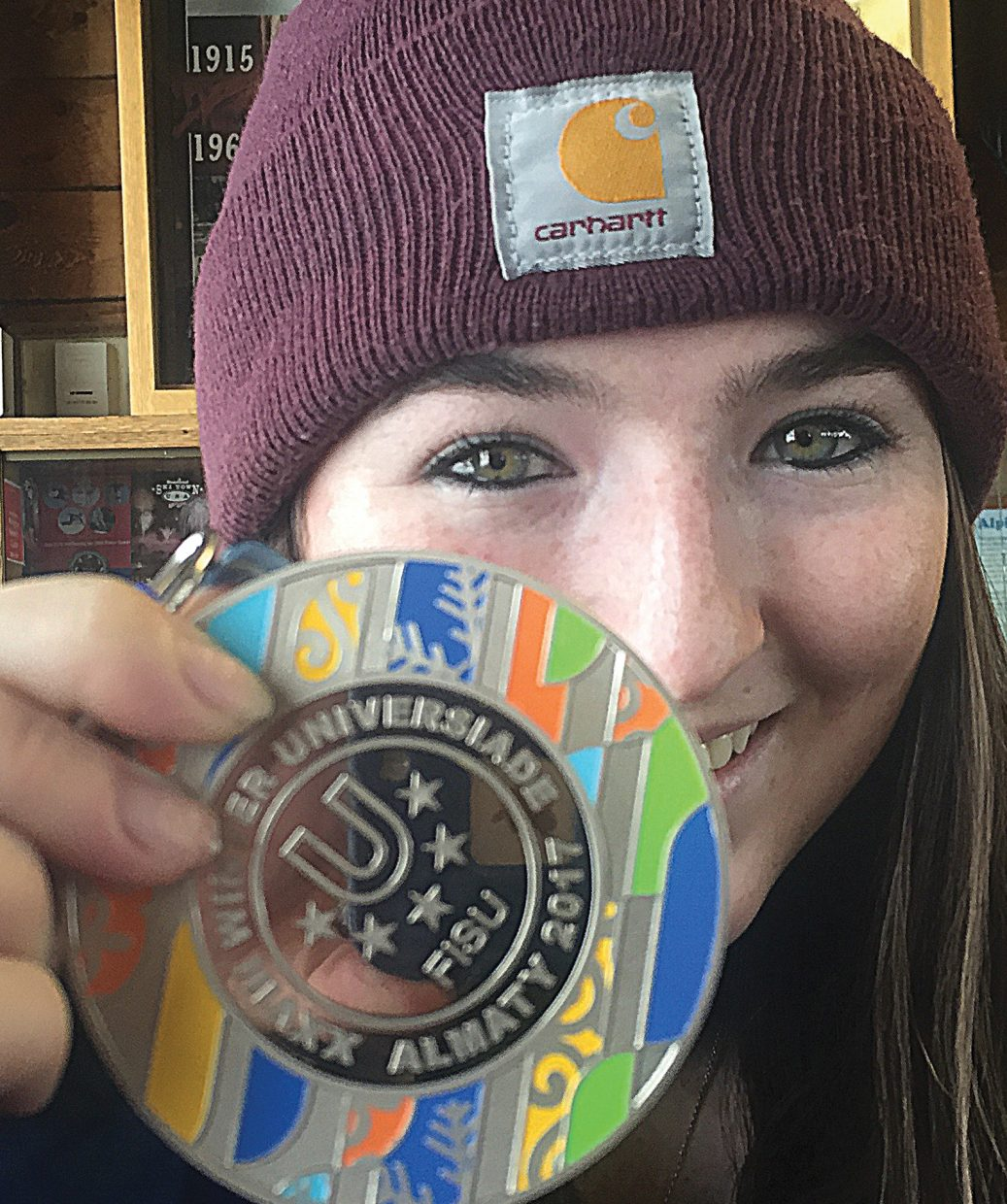 Maggie Rose Carrigan shows off the medal she won at the Winter Universiade 2017 in Almaty, Kazakhstan, last week. Carrigan is currently leading the NorAm women's Alpine snowboarding standings and is hoping to have a shot at the Olympics Games someday — this despite being diagnosed with adolescent idiopathic scoliosis when she was 10.