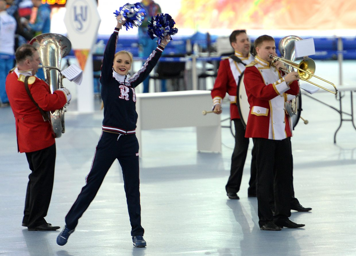 A group of cheerleaders and a band entertained twice during Saturday's men's 5,000-meter speedskating championships at the 2014 Winter Olympics in Sochi, Russia.
