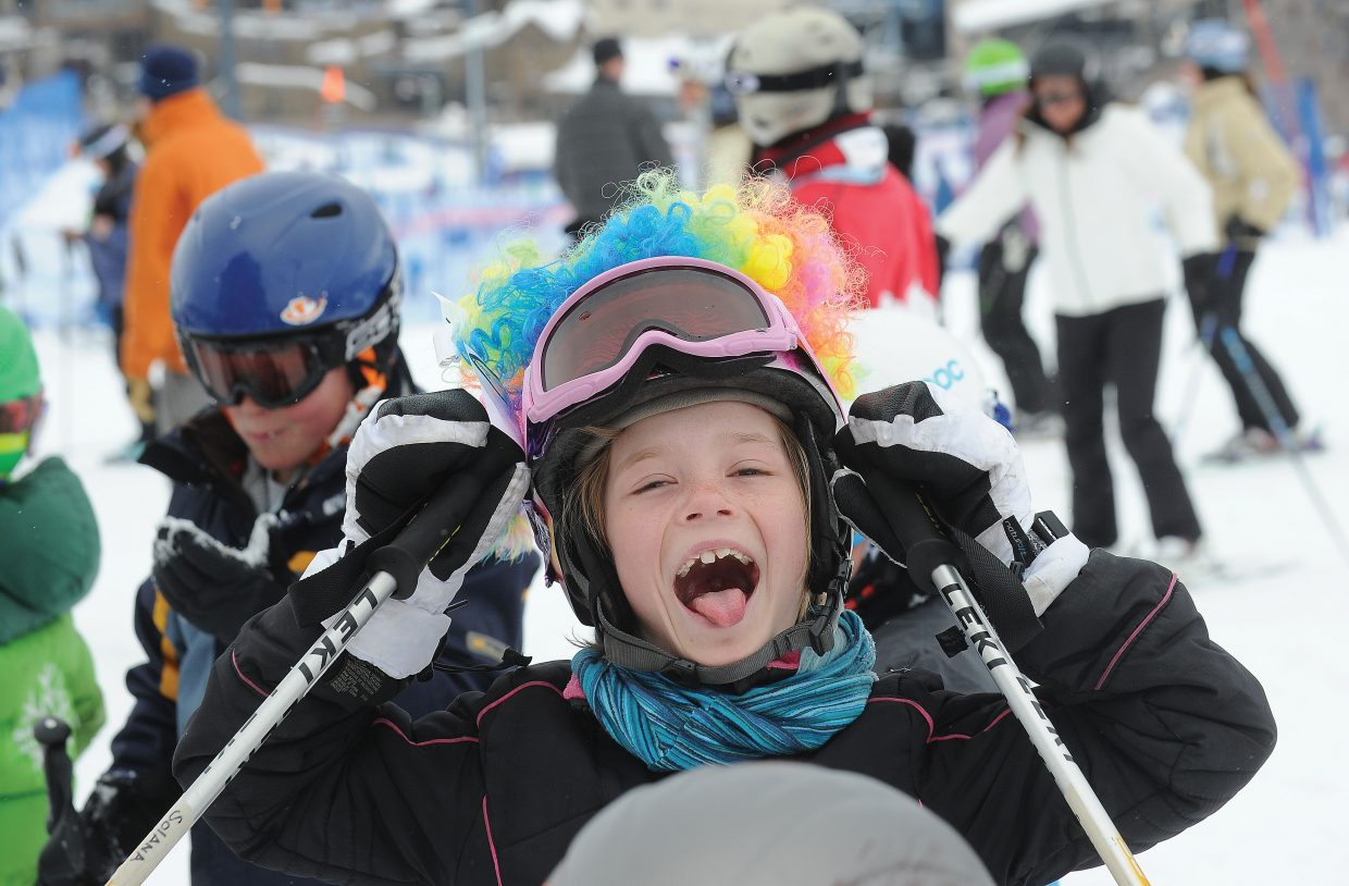 Solana Brown, 8, goofs around with friends while waiting for her shot at the race course Friday morning during the annual Soda Pop Slalom at Steamboat Ski Area. The Steamboat Springs Winter Carnival event is a rite of passage for young skiers in Steamboat Springs and serves as a preview to a weekend full of snow-filled fun.
