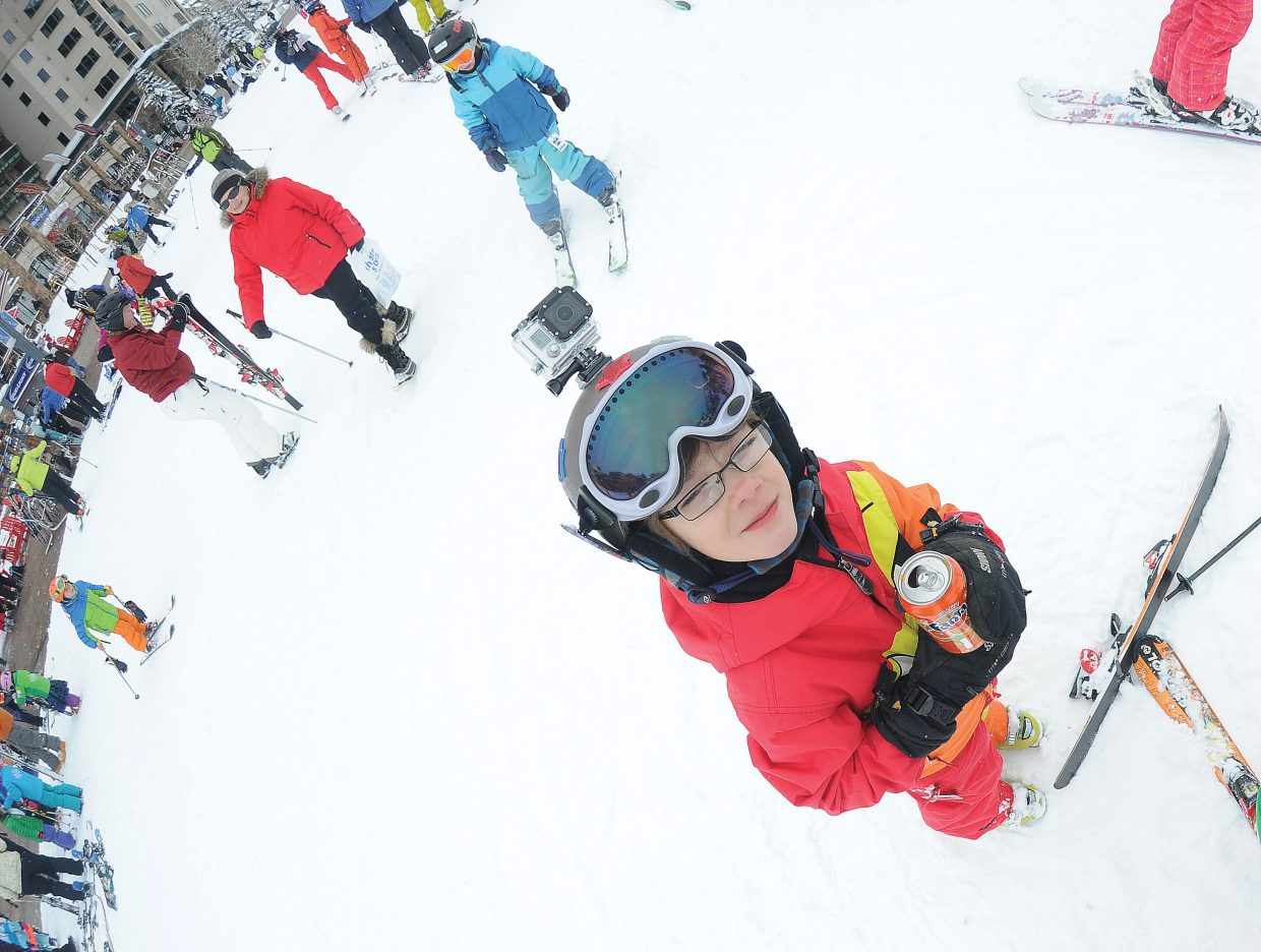 Jack Sulentich enjoys a soda after completing his run in Friday's Soda Pop Slalom at the base of Steamboat Ski Area.