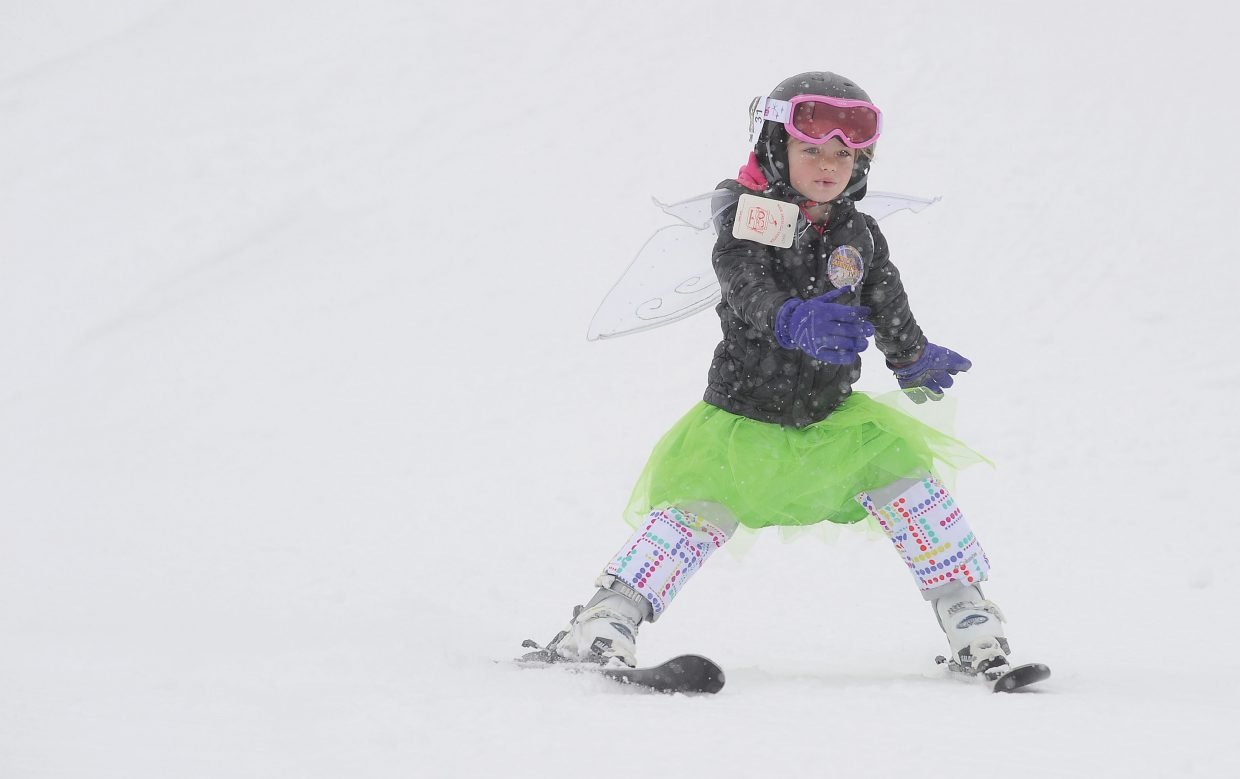 Complete with wings and a tutu, 5-year-old Emmy Watson makes her way down the race course during Friday morning's Soda Pop Slalom. The Steamboat Springs Winter Carnival event is a rite of passage for young skiers in Steamboat Springs and serves as a preview of a weekend full of snow-filled fun.