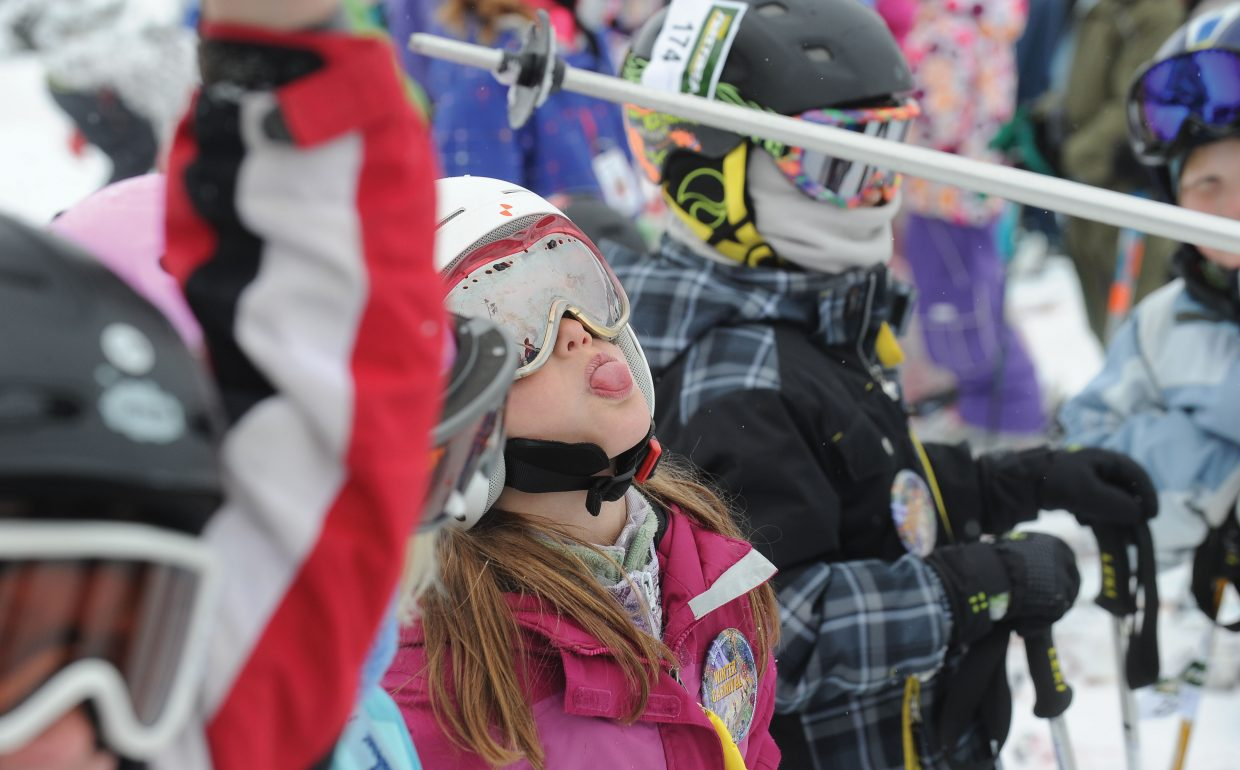 Lila Boniface, 8, attempts to catch a snowflake on her tongue while waiting for her turn Friday morning during the annual Soda Pop Slalom at Steamboat Ski Area. The Steamboat Springs Winter Carnival event is a rite of passage for young skiers in Steamboat Springs and serves as a preview of a weekend full of fun.
