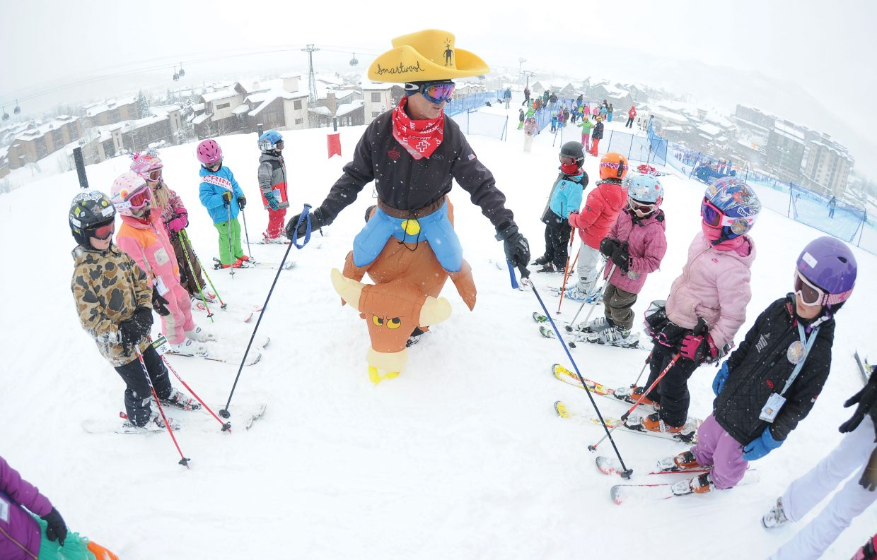 Volunteer sheriff Craig Keefe lines up racers near the start of the annual Soda Pop Slalom at Steamboat Ski Area. The Soda Pop Slalom is a long-running Winter Carnival tradition in Steamboat Springs.